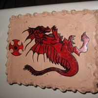 Red Dragon This is a white cake with chocolate buttercream, the dragon was drawn on red gumpaste and painted with black food coloring deluted with...