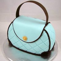 Tiffany Purse This cake was made from an 8 inch round, with the top and bottom cut off to form the purse. Covered in fondant and adorned with embossed...