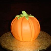 Mini Pumpkin This mini pumpkin was done using Wilton's mini ball pan. I stuck to halves together and covered with fondant, using the handle of a...