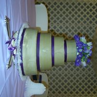 Potts Wedding Cake Butter cream icing and purple ribbon with real flowers