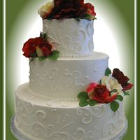 "Tt's Wedding Cakes 22 Silk Flowers, 6"", 8"" and 12"" round cakes. Free-hand scroll-work."