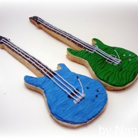 Guitar Cookie! I made this for a friend. It's replica's of his PRS guitars. NFSC with royal icing.