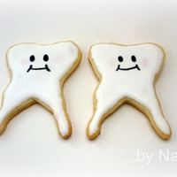 Tooth Cookies! Sugar cookies with royal icing. I made these for a Christmas gift for a friend who is in school for dentistry. Enjoy!