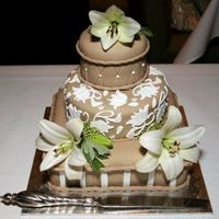 Round Wedding Cake this is a mocha and white wedding cake with real flowers o top