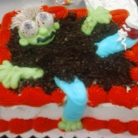 Zombie In Cake buttercream icing and oreo crumbs