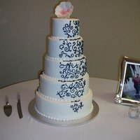 Kaci's Cake   My son and new daughter's wedding cake. First time to ever do a sugar flower