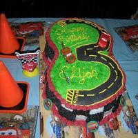 Cars Cake For My 3 Year Old Son Cake I made for my son, he is a huge Cars fan. Thanks to all the wonderful people who gave me the ideas on this website!! I know it has a...