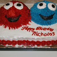 Elmo And Cookie Monster 9X13 pan and mini ball pan, all buttercream.