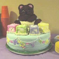 "Baby Bear With Blocks On A Blanket Photo 1 of 2. This is my first tiered and shower cake :). It is a 14"" WASC covered in MMF. The bear is BC and the blocks are fondant..."