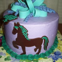 Jocelyn's Horse WASC with buttercream frosting. The horse is modeling chocolate traced from a picture, gumpaste bow.