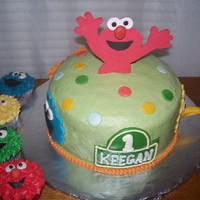 Sesame Street A really fun and challenging Sesame Street cake. Elmo is gumpaste. All the other characters are fondant with buttercream details. Cake is...