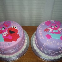 Elmo & Abby Royal icing plaques on buttercream.