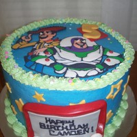 Toy Story 3 Toy Story cake. Top is royal icing plaque. Buttercream with fondant accents.