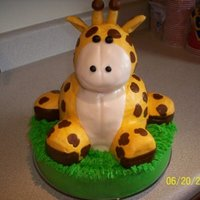 Stretch The Giraffe I carved the body from cake and the head is made from rice crispy treats.....It was a fun cake to make. :)