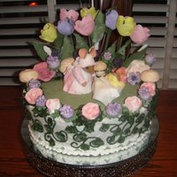 Sweet Emmaline I did this cake for my sisters baby shower. I made the mice and tulips from Fondant. The mushroom are made from meringue and the flowers...