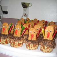 Turkey Cupcakes Chocolate cupcakes. Buttercream frosting. Nutter butter cookies for the turkey body. Fruit roll ups for the feathers.