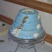 Ocean Theme Wedding Cake The bottom layer of this cake is two tone cheesecake. The top two layers are cake dummies. All three layers are covered in fondant. The...