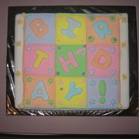 Quilt Birthday Cake. This is a dummy cake covered in fondant. It has royal icing and fondant accents.