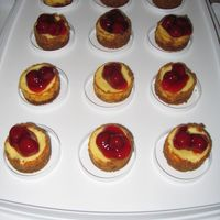 Mini Cherry Cheesecakes These are mini cheesecakes topped with cherries.