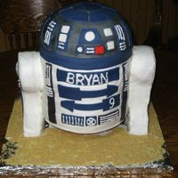 R2D2 Cake I made this for a friend of mine for his son's 9th birthday. I think R2 wound up with quite fat arms. :)