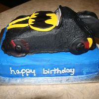 Batmobile This was for a mother who didn't want fondant so I only used fondant accents. I'm just not good at getting very smooth icing but...