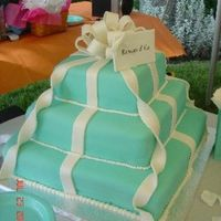 Tiffany & Co. Wedding Cake   Cake is covered in fondant and all accents are made from fondant. I matched a Tiffany's bag (used in background to hold napkins.)