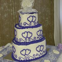 Purple Heart Wedding Cake Purple and White Heart Wedding Cake in the shape of Hearts.
