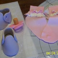 Getting Ready Drying shoes, pacifier and socks for cake