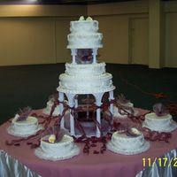 Wedding Cake wedding cake with pearls, bc frosting, white cake, maroon accents, gumpaste calla lillies, fountain