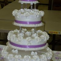 100_0634.jpg The brides favorite color was lilac, so the cake had lilac ribbon and white bluebells with lilac centers.