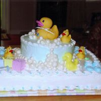 Baby Ducky sheet cake with round top cake iced with BC, bubbles made with fondont