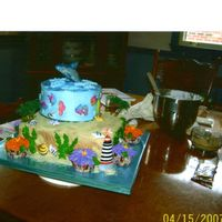 Day At The Beach cake made with buttercream icing, and dolphan made with white candy melts then air brush