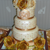 Golden Anniversary Cake This cake was made for my parents 50th wedding anniversary. It is a 6-8-10'' layer cake. It was covered in ivory colored mmf and...