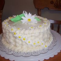 "Gum Paste Daisy Flower Cake My first attempt of the basket weave on my own!! Made the flowers from Gum Paste, they were alot of fun. The icing is the ""crusting..."