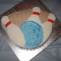 Strike! bowling banquet cake for a small local bowling league. The ball is white & 2 shades of blue; border matches colors of the ball; all...
