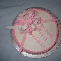 Birthday Loop 2 layer birthday cake for 92 year old!; white buttercream trimmed with pink shell border & multi-loop bow in pink & white