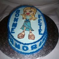Bratz Birthday Cake Simple vanilla cake with butter cream (in 2 shades of blue); Bratz kid is a chocolate transfer.