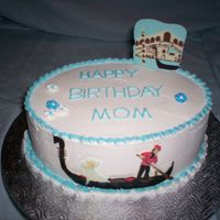 Gondola Birthday cake for a lovely large originally from Venice, who just turned 80. She likes the color blue & likes things to be simple; the...