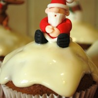 Santa Cupcake  The cream cheese topping on these carrot muffins gives a great snow look and is extremely tasty. The Santa figure is totally edible,...