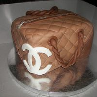 Chanel Purse Butter cake, chocolate fondant, with buttercream filling. First paid customers. Made for husband's co-worker's wife. He was very...