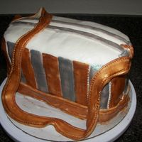 Gold And Silver Purse Cake  This cake is a flashback to the past. I had a purse like this in high school. I wanted to do someting sentimental. I enjoyed doing this...