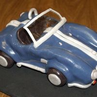 English Car first place 'fair theme' winner old English car. Fondant over pound cake. I used confectioners glaze for the shiny bits and...
