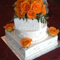 "Fall Wedding 10"" square, 8"" round, 6"" square. Fresh roses, buttercream. Top assembled in a ""blob"" of fondant to hold it. The..."