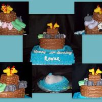 Noah's Ark First birthday cake, fondant animals, buttercream icing. Ark is Wilton oval pan (comes in the course 2 kit) with a square cut out of scraps...