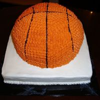 Basketball Groom's Cake   BC. Made with sport's ball pan on a 10 square (I think)