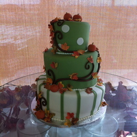 Autumn's Cake Fall-themed wedding cake inspired by a photo the bride found. Gumpaste autumn leaves and homemade fondant.