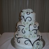 Ana's Cake Variation on a theme. Chocolate fondant swirls with light sage gumpaste roses.