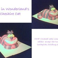 Cheshire Cat MMF fondant covered cake......wondermold body, cake molded for head, arms and tail. buttercream crumb coat and mmf fondant in violet and...