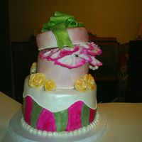 Topsy Turvy Jewelry Box White cake, vanilla buttercream, covered in fondant, flowers, bow, and tissue paper are gumpaste painted with luster dust and grain alcohol...