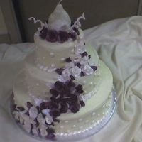 Burgundy And White Roses For Coptic Egyptian Wedding Yellow cake, vanilla buttercream base icing, borders and dots in royal brushed with super pearl luster dust, roses, leaves, and spirals in...